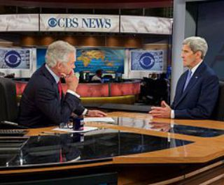 Secretary_Kerry_Speaks_on_'CBS_Evening_News'_Set_in_New_York_With_Anchor_Pelley_Before_Interview_Focused_on_Iran_Nuclear_Deal_wikicommons320x265