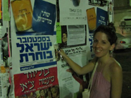 Peace Now Woman Activist Placing Flyer 186x140.jpg