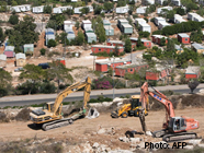 Settlement_Construction_AFP_186x140.jpg
